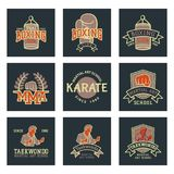 Set of cool fighting club emblems martial training champion graphic style punch sport fist karate vector illustration. Set of cool fighting club emblems, labels Stock Photos