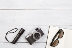 Set of cool travel stuff on wooden table Royalty Free Stock Photography