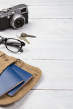 Set of cool travel stuff on wooden table Stock Images