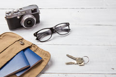 Set of cool travel stuff on wooden table Stock Image