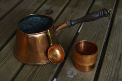 Set of copper cookware coffee on wooden table Royalty Free Stock Photo