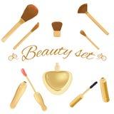 Set of cosmetic brushes, mascara, lipgloss and. Elegant collection of fashion cosmetic brushes, mascara, lipgloss and perfume bottle. Luxurious and elegant set Stock Image