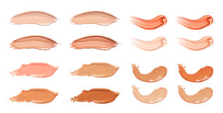 Set of cosmetic liquid foundation or caramel cream in different colour smudge smear strokes. Make up smears isolated on Royalty Free Stock Photography