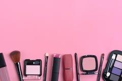 Set of cosmetics and accessories. Lipstick, perfume, eye shadow, mascara, ring, nail polish, eyelash forceps, blush, earrings on pink background Chriastmas stock photos