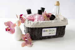 Set of cosmetics for body care in a wicker basket on a white table Royalty Free Stock Photo
