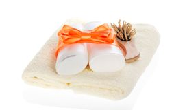 Set of cosmetics with bow and wooden hairbrush Royalty Free Stock Photo