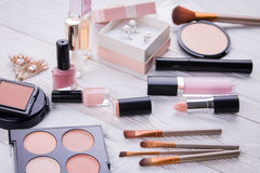 Set of cosmetics and jewellery Stock Images