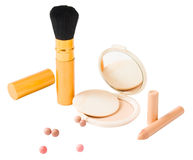 Set of cosmetics and make-up tools isolated. Different types of cosmetics, brush, pressed powder, pencil, bronzing pearls isolated on white Stock Image