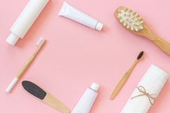 Set of cosmetics products and tools for shower or bath with copy space for text or design on pink background. Concept female stock image