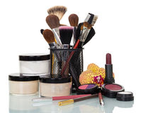 Set  cosmetics and professional brushes for makeup isolated on white. Royalty Free Stock Image