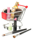 Set of cosmetics tubes in shopping cart Stock Photos
