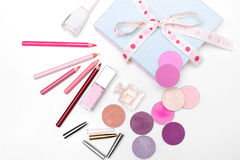 The set of cosmetics. the view from the top. Set of cosmetics: eye shadow, lipstick, lip pencil, lip pencil, perfum. top view Royalty Free Stock Photography