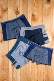 Set of cotton panties for boy clothes on wooden boards. Top view royalty free stock photo