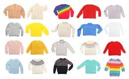 Set of cozy warm sweaters. On white background stock photo