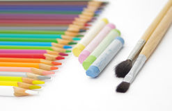 Set of crayons, pastel and brush. Set of crayons on white Stock Photography