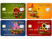 A set of credit cards with floral designs Stock Photos