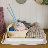 Set of crochet on wooden table Stock Image