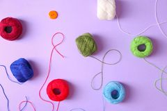 Set of crocheting clews on color background. Top view Royalty Free Stock Images