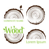 Set a cross section of the trunk with tree rings. Vector illustration. Logo. Tree growth rings. Tree trunk cross-section. Stock Photo