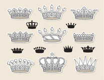 Set crowns. Set of nine crowns and nine silhouettes of crowns Stock Photo