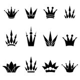 Set of crowns. Black crowns isolated on white background, may be used as logos and icons Royalty Free Stock Image