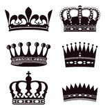 Set of crowns. Illustrated set of silhouetted crowns isolated on white background Royalty Free Stock Image
