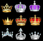 Set of crowns with precious stones on a black background Royalty Free Stock Photography