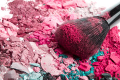 Set of crushed eyeshadows. Set of multicolor crushed eyeshadows with brush royalty free stock photo