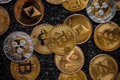 Set of cryptocurrencies. With a golden bitcoin on the middle stock photos
