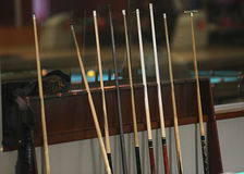 Set of cues. In the billiard room royalty free stock images