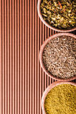 Set cumin,hops-suneli,paprika in a wooden bowl close-up Stock Photos