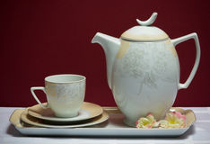 Set of cup, tea-pot, tray and saucers  with flower Stock Photo