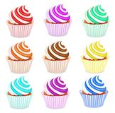 Set of cupcakes with fruit cream Stock Photography