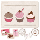 Set of cupcakes on old postcard, with stamps Royalty Free Stock Photos
