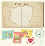 Set of cupcakes on old postcard, with stamps Royalty Free Stock Images