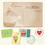 Set of cupcakes on old postcard, with stamps Royalty Free Stock Photo