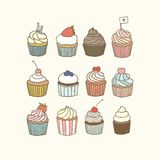 Set of 12 cupcakes. Vector EPS 10 hand drawn illustration Stock Image