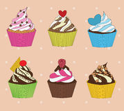 set of cupcakes on vintage background Royalty Free Stock Image