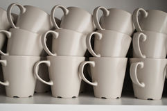 Set of cups in the kitchen. Set of big cups in the kitchen Royalty Free Stock Photography
