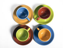 Set of Cups and saucers. Fiesta colored set of four cups and saucers Stock Image