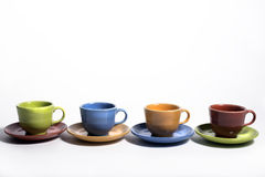 Set of Cups and saucers. Fiesta colored set of four cups and saucers Stock Photos