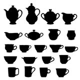 Set of cups and teapots Royalty Free Stock Photo