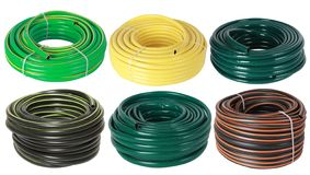 Set of curled plastic  garden water hoses pipes isolated. On white royalty free stock photos