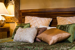 Set of cushions on the bed Stock Images