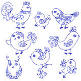 Set of cute birds curly. Set of eight cute birds with swirls, handmade Royalty Free Stock Photography