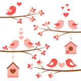 Set of cute birds in love on blooming branches