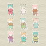 Set of cute cartoon cat dressed Royalty Free Stock Photos