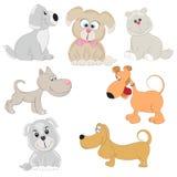 Set of cute cartoon dogs. Stock Photos