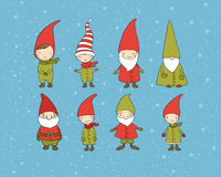 Set of cute cartoon gnomes. Funny elves. Hand drawing isolated objects on white background. Vector illustration. Stock Photography