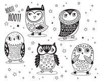 Set of cute cartoon owls with ethnic ornament in outline Royalty Free Stock Photo